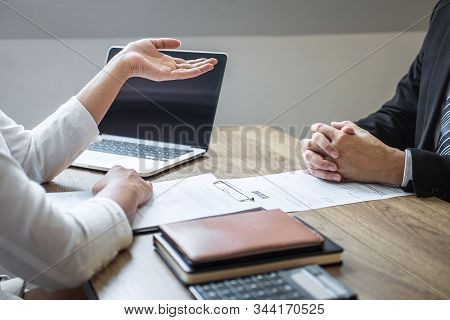Employer Or Recruiter Holding Reading A Resume With Talking During About His Profile Of Candidate, E