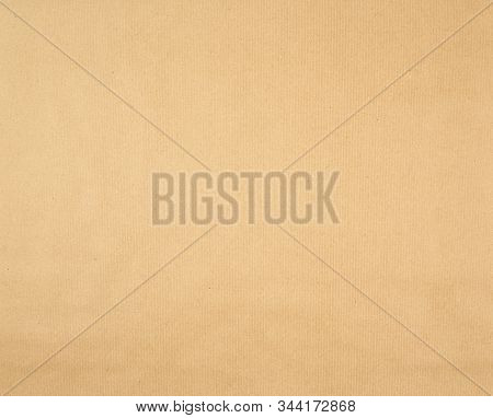 Texture Of Smooth Brown Kraft Wrapping Paper, Full Frame. Clean Sheet, Template.