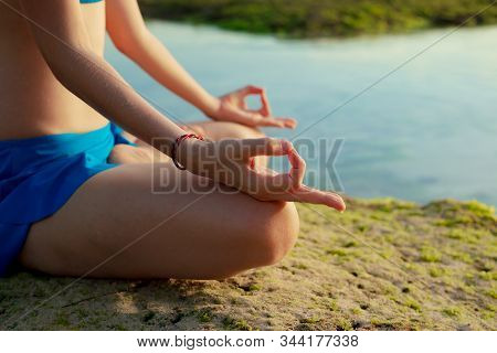 Lotus Yoga Pose. Close Up Gyan Mudra. Focus On One Hand. Yoga At The Beach. Young Woman Sitting On S