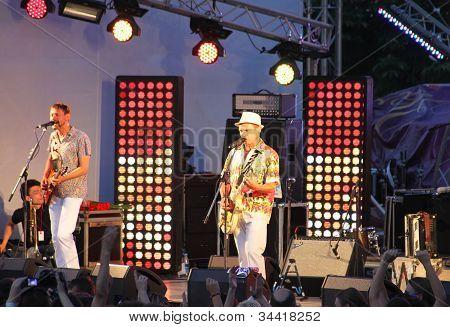 Ukrainian Singer Oleg Skripka (right) And Band