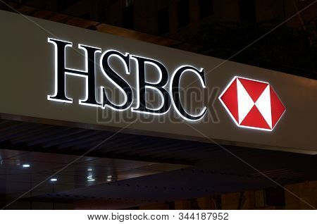 Brisbane, Queensland, Australia - 20th December 2019 : Illuminated Hsbc Bank Sign Hangin In Front Of