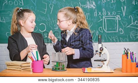 Biology Lab. Happy Genius. Chemistry Research In Laboratory. Little Girls Scientist With Microscope.