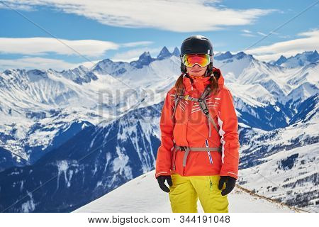 Confident Woman Skier Posing For A Portrait In The French Alps, Les Sybelles Ski Domain, France, On