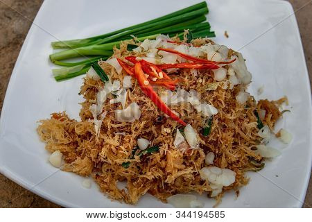 Asian Eating Food, Mee Grob Is An Sweet And Sour Crispy Noodles, Made From Thai Rice Noodle With Swe