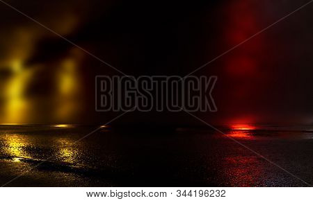 Wet Asphalt, Reflection Of Neon Lights, A Searchlight, Smoke. Abstract Light In A Dark Empty Street