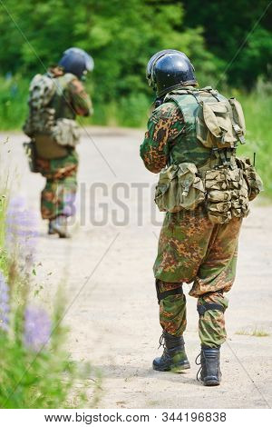 Military soldier armed with rifle gun