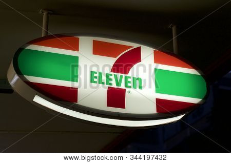 Brisbane, Queensland, Australia - 11th December 2019 : Illuminated 7eleven Sign Hanging In Front Of