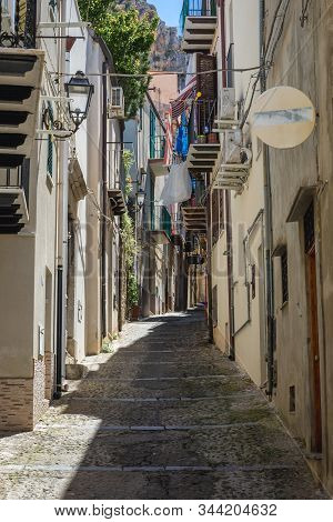 Typical Street On The Old Town Of Cefalu City On Sicily Island In Italy
