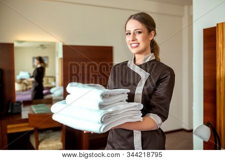Cleaning Maid Bringing New Towels