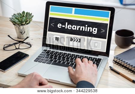 E Learning, Online Training And Education, Distance Learning Concept. Man Working With A Computer La