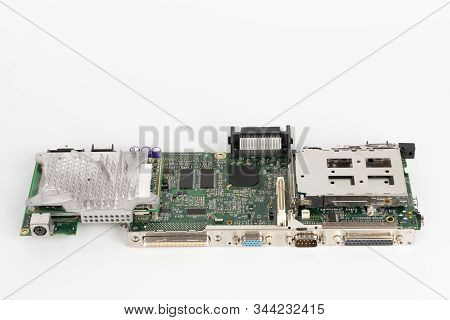 Close Up Of Motherboard Old Laptop With Parallel, Serial , Vga, Ps2 Port And Cooler Of  Microprocess