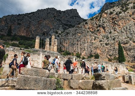 Delphi, Greece - September 21, 2017: Tourists Visit To Temple Of Apollo In Delphi, Central Greece