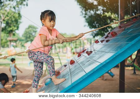 School Kids Play And Learn In The Playgound. Physical Activity Like Climbing Are Good For Develop Mo