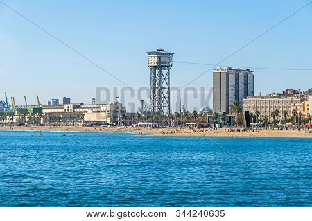 Barcelona, Spain - November 2, 2019: Beach Platja De St.sebastia And A Free Standing Lattice Tower T