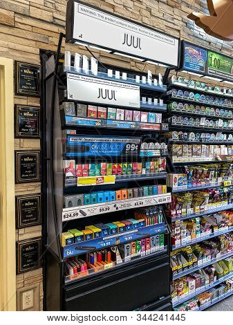 Orlando,fl/usa-12/27/19: Juul Brand Ecigarettes In A Case At A Wawa Gas Station Convenience Store.