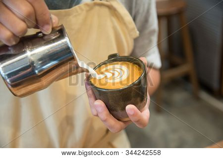 Barista Pouring Milk In To Coffee Cup Making Beautiful Latte Art.coffee Latte Art In Coffee Shop