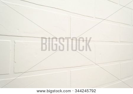 White Brick Wall Background. Close Up Modern Indor Interior Texture. Surface Building, Masonry At An