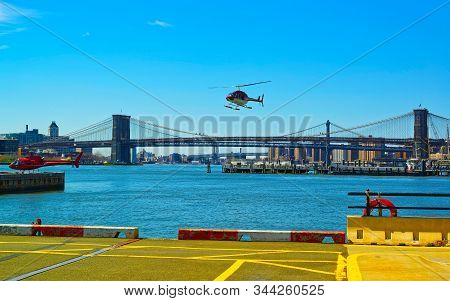 Helicopters Near Brooklyn Bridge And Manhattan Bridge And East River Reflex