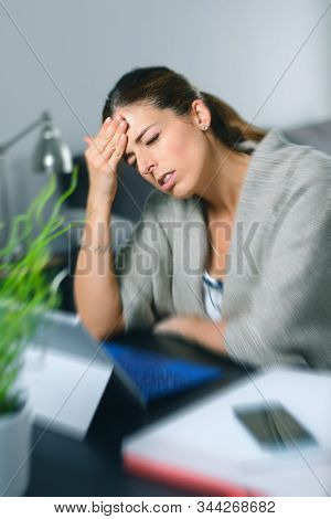 Sick Dizzy Young Woman Suffering Headache While Working On Her Laptop At Home.
