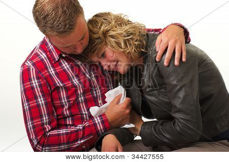 Man giving comfort to young woman