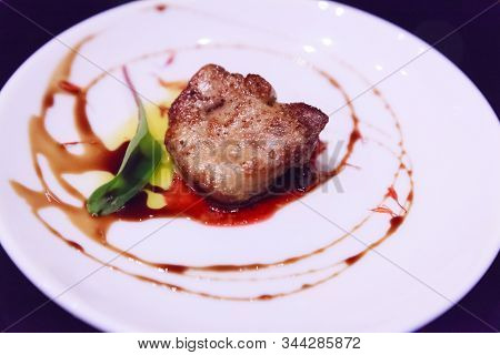 Delicious Fresh Sliced, Pan Seared Foie Gras With Berry Sauce Decoration Served On White Porcelain P