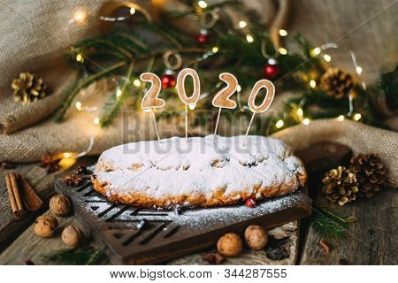 Christmas Homemade Traditional German Bread Stollen With Powdered Sugar And Inscription 2020 On Top