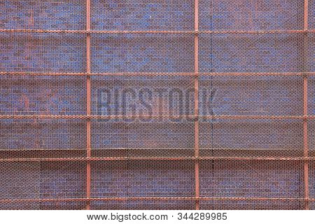 Welded Metal Steel Wall Mesh Netting Outside Building Construction, Decoration Background. Safety, S