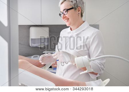Gynecologist With Vaginal Speculum In Clinic Before Patient Examination