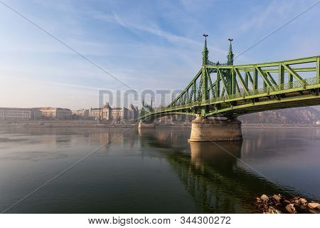 The Liberty Bridge In Budapest In Hungary, It Connects Buda And Pest Cities Across The Danube River.