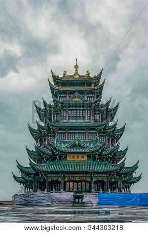 Ancient Hongen Temple Pagoda Tower With Green Tile Under Overcast Weather In Chongqing, Southwest Ch
