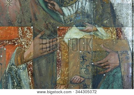 Restoration Of Painting. Fragment With Probing In The Process Of Restoration. Old Painting.