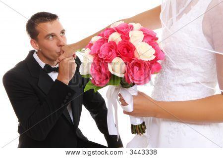 Groom Kissing Bride At Wedding