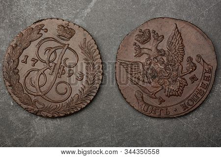 Numismatics. Old Collectible Coins Made Copper On A Wooden Table. Top View. Black Backgraund.