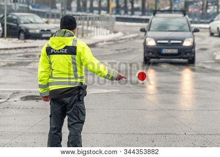 Traffic Policeman Stops The Car. Cop With Stop Sign