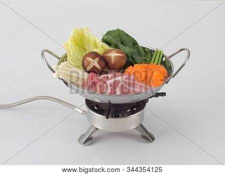 Japanese Sukiyaki In The Pot Isolated On White Background
