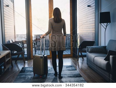 Traveler Girl In Hotel Room In Vacation. Young Girl Traveler Relaxing In Vacation. Traveler Holding