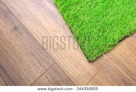 Artificial Grass Lie On The Laminate Floor