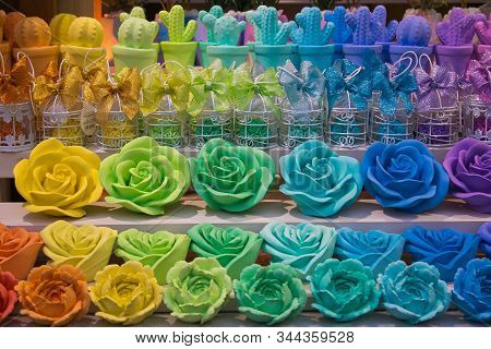 Colored And Beautiful Rose Candles At The Christmas Market Of Ascoli Piceno In Italy