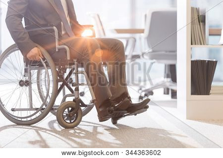 Disabled businessman on wheel chair in office