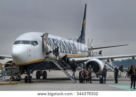 Porto, Portugal- January 8, 2020: Passengers Getting Off The Plane Of Ryanair Company At The Porto A