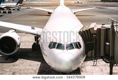 Front View Of Airplane Near Airport Runway Ready To Takeoff - Wanderlust Travel Concept Around The W