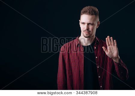 A Discontented Lad Showing Stop Palm Gesture