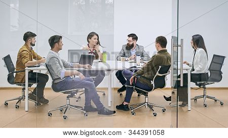 Corporate Business Team And Manager In A Meeting At It Company Office Conference Room. View Through