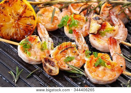 Grilled Shrimp On Skewers. Grilled Seafood On Skewers With Spices, Herbs And Lemon. Delicious Prawn.