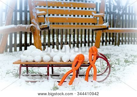 Sleigh And Snowballs With Snowball Maker In Wintery Garden
