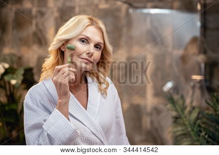 Calm Lovely Lady Massaging Her Facial Skin