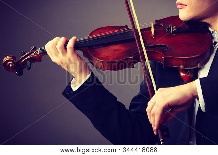 Music Passion, Hobby Concept. Close Up Young Man Man Dressed Elegantly Playing On Wooden Violin. Stu