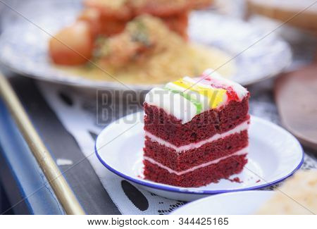 Fresh Homemade Delicious Multilayered Red Velvet Cake Topped With Colorful Whipped Cream, Perfect Fo
