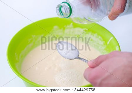 Baking Soda Is Quenched With Vinegar. A Spoon Of Soda And A Plastic Bottle. The Process Of Making Do