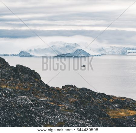 Arctic Nature Landscape With Icebergs In Greenland Icefjord With Midnight Sun Sunset Sunrise In The